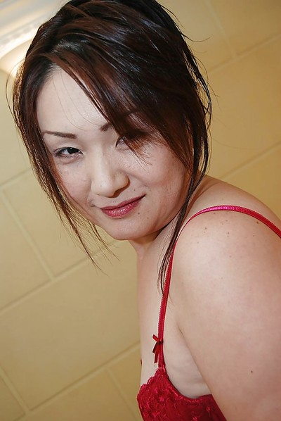 Japanese MILF Yasuyo Kajita undressing and showcasing her muff in close up