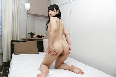 Sassy Japanese babe exposing her ample booty and bushy cooter exactly after bathroom