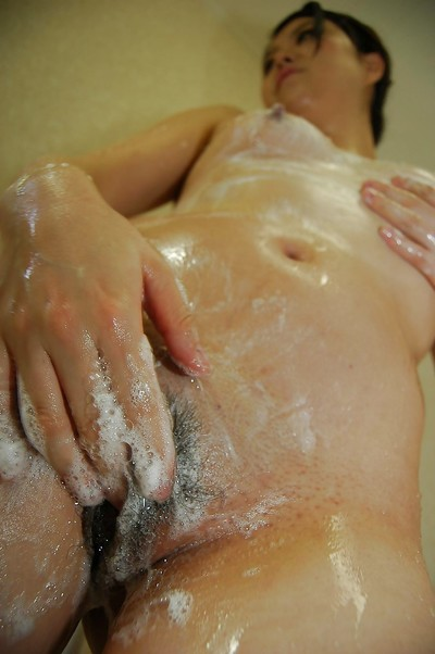 Japanese princess with tough tit buttons tempting bathroom and rubbing her soapy bush