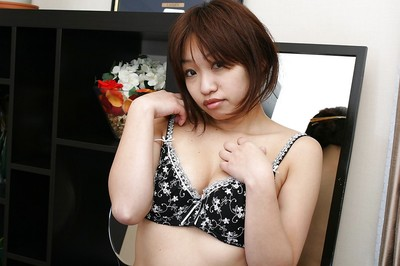 Japanese MILF Rika Okabe undressing and demonstrating her cage of love in close up