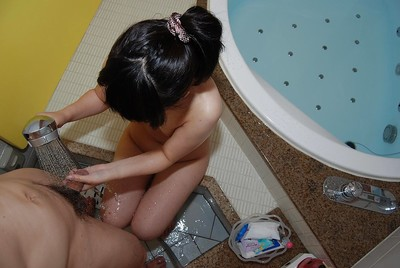 Chinese young Chisa Nagata gives a corporeal hand and dick sucking in the baths