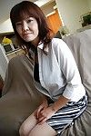 Chinese lass Kimie Kuwata undressing and exposing her goods in close up