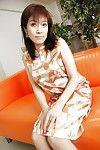 Chinese MILF Shinobu Yabe undressing and exposing her twat in close up