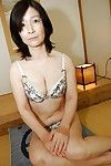 Appealing Japanese seasoned lassie getting undressed and exposing her hairy gash