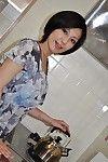 Beautiful Japanese MILF Mayumi Iihara undressing and jerking off her muff