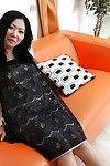 Sassy Japanese MILF undressing and amplifying her unshaved wet crack in close up