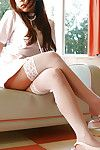 Seductive Chinese darling with major jugs erotic dancing off her nurse uniform