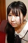 Shy oriental schoolgirl getting bare and exposing her wet cage of love in close up