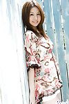 Smiley Japanese chicito Tatsumi Yui slothfully striptease off her