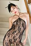 Adolescent Japanese queen exposing swollen love button in crotchless bodystocking
