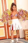 Young Oriental doll loosing little love muffins from cheerleader uniform