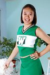Young Eastern freeing huge boobs and butt from underside cheerleader uniform