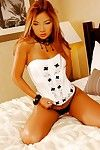 Pornstar redhead Jenny Chu way in her hawt strings on her knees
