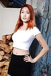 Redhead Oriental number 1 timer Lea Hart exposing skinhead bawdy cleft outdoors