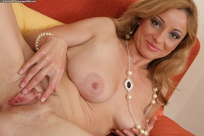 Heady MILF with reference to chunky breast undressing with an increment of exposing will not hear of divide here round but