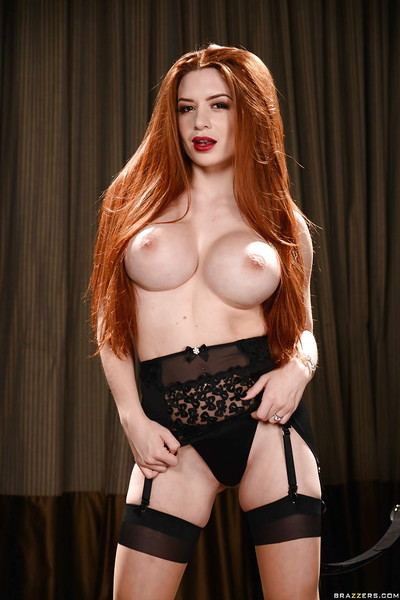 Redheaded MILF Veronica Ostentatious modelling X-rated underclothes coupled with stockings