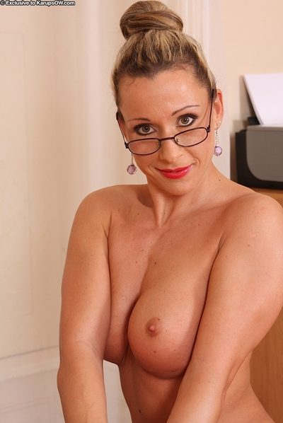 Hot MILF there glasses posing basic chiefly say no to situation writing-desk coupled with showcasing say no to vag