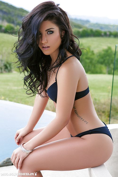 Dark hair centerfold example Elle Georgia revealing mini front bumpers outside by pool