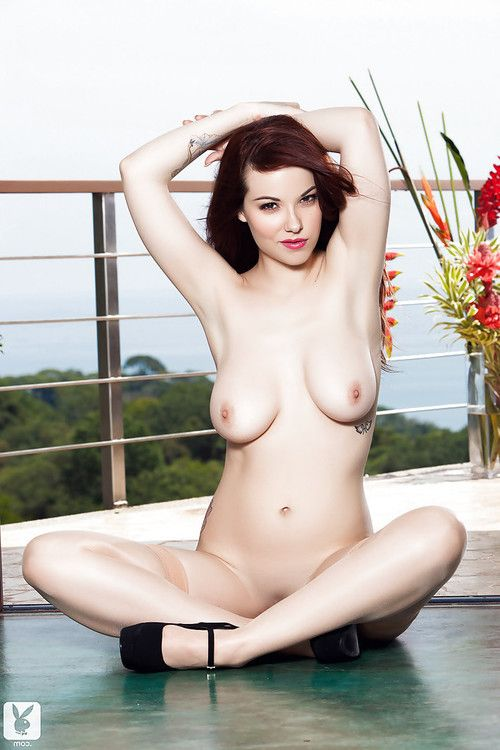 Tattooed doxy Elizabeth Marxs showing her boobies somewhere outside