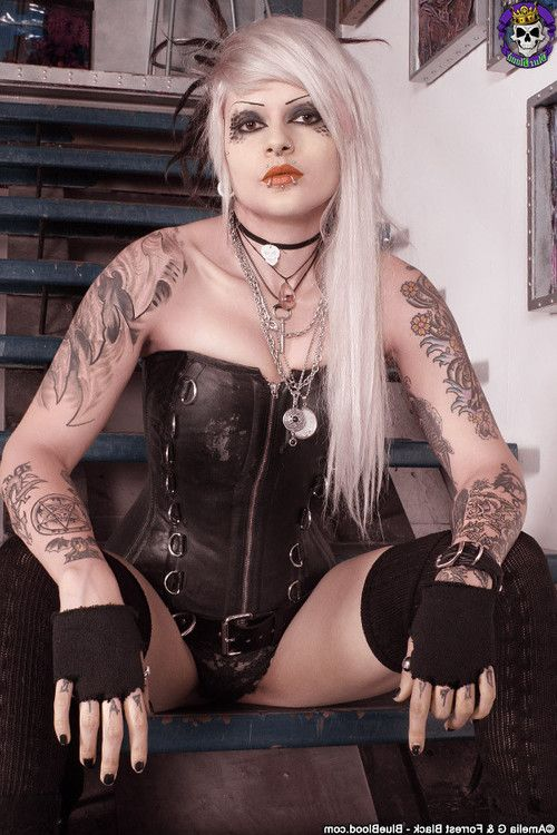 Wild tattooed elegant waste goth in leather corset