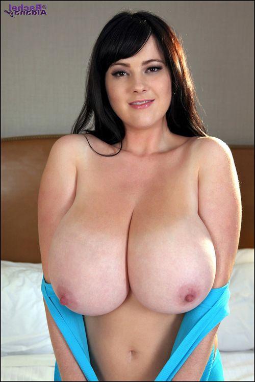 Rounded Rachel Aldana reclines on a sofa in blue
