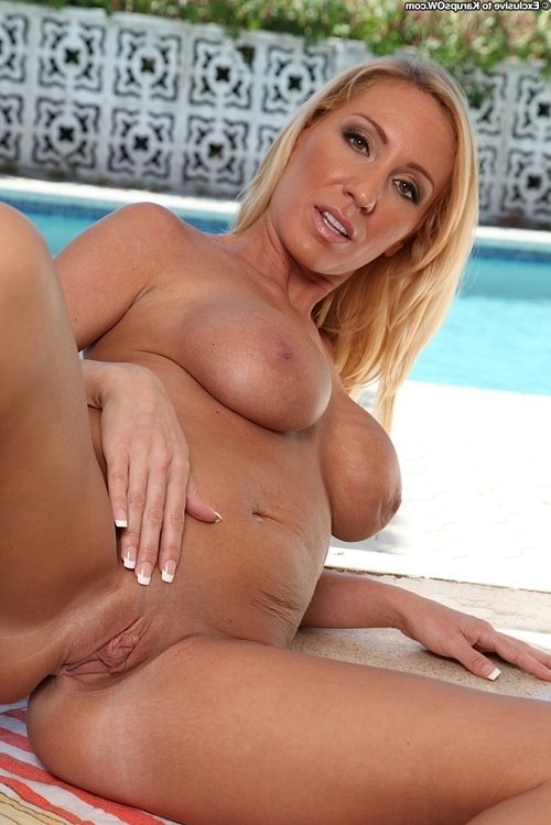 Golden-haired MILF Toni Taylor releasing fine breasts and shaved cunt from bikini