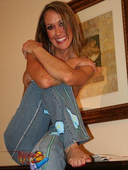 Brandi love in rigid blue jeans