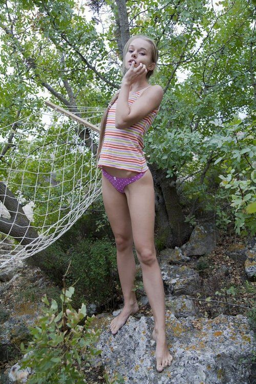 Barefoot youthful Milena D disrobes cotton shorts to play with dick in the forest