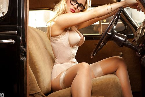Titsy fairy-haired model in underware Ancilla Tilia posing in the car