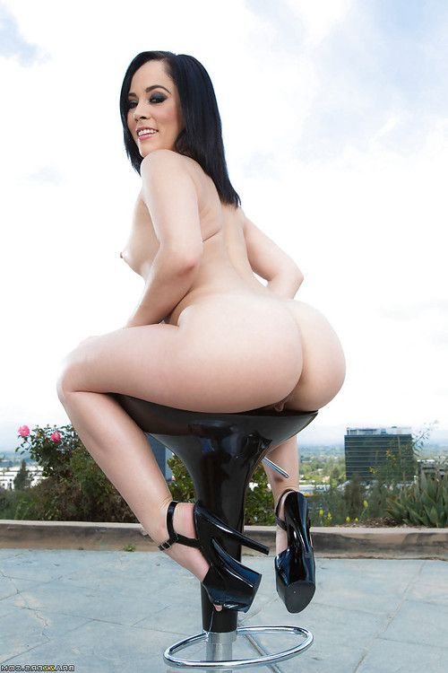 Brunette hair darling Kristina Rose flaunting nice Latin babe MILF booty outdoors