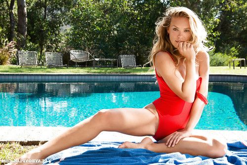 European centerfold beauty Kristy Garett shedding underwear outdoors by pool