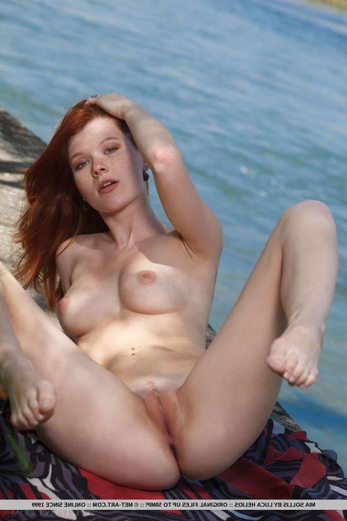 Glamorous ginger courtesan Mia Sollis undresses down totally at the beach