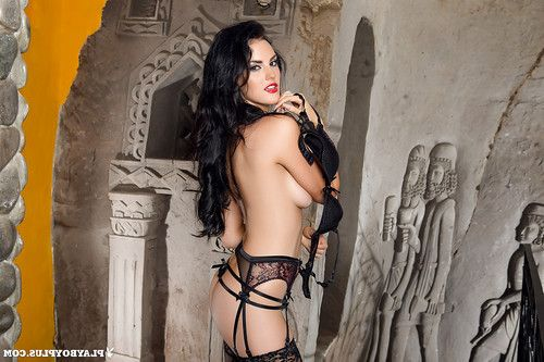 Leggy dark hair centerfold case Ashleigh Hannah posing topless in garters