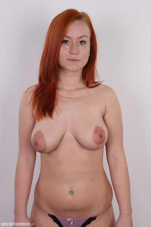 Breasty redhead posing in  casting images