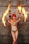 Tattooed redhead hotty fire dancer heats things up