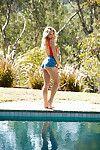 European centerfold beauty Kristy Garett shedding underwear outdoors by pool