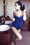 Boobsy centerfold doll Vivien getting naked and ravishing a washroom