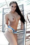 Elegant brunette hair Vivien way entirely dressed in short underclothing and white dominant