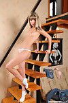 Lovable babe on stairs