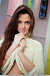 Lusty juvenile dark hair Kamilah pulls up her sweater to reveal her uterus