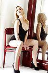 Seductive blond princess Melanie Taylor slipping off her sexy pants