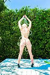 Marvelous blond girl Stacy Aaron showcasing her graceful body outdoor