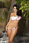 Full-bosomed brown hair Bunnie Brook slipping off her bikini outdoor