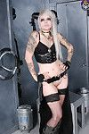 Tattooed industrial queen in boots and leather