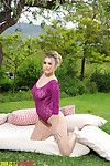 Summer undresses from her observe during purple lace bodysuit outdoors.
