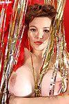 Breasty Danielle Riley standing as a burlesque dancer