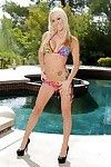 Leggy blond model Zoey Portland freeing vast pornstar breasts outdoors by pool