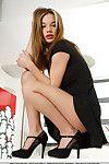 Appealing Euro queen Nici Dee crosses sleek legs in high heels previous to posing in nature\'s garb
