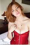 Glamorous redhead Kika displaying shiny on top cage of love prior to freeing gigantic accustomed milk cans