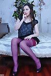 Upskirt girl in purple stockings with a red girdle finds a equipment for her equipment box